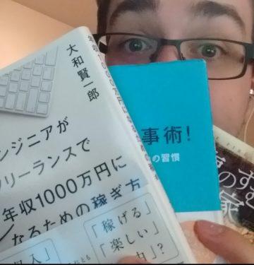Matt holding 3 japanese books